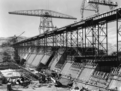 Photograph of Friant Dam under construction, circa 1940. From the Woodward collection.