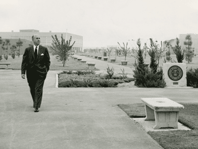 Photograph of President Arnold Joyal walking across the Fresno State campus, circa 1958.