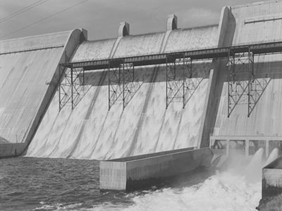 Black and white photograph of a dam waterway from collection.