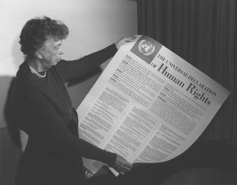 A woman reading the Universal Declaration of Human Rights